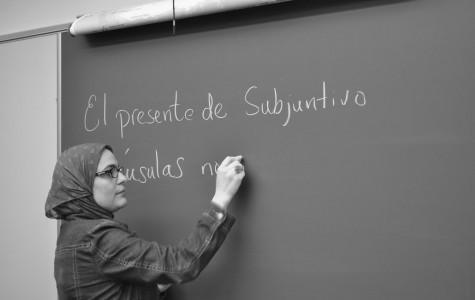 New Spanish teacher Coralie Sabir mimics her teaching style.