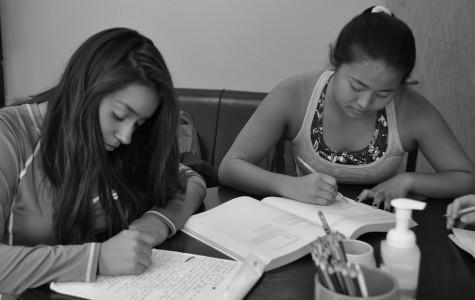 Priscilla Roman and Sonya Vaintrub study for multiple standardized tests.