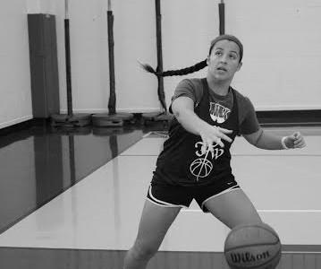 Senior Julia Turner practices her ball handling.