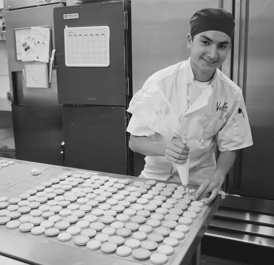 Danny Sickle fills macarons as he works in the kitchen of Vanille.