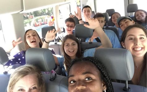 Students take a selfie while on the bus.