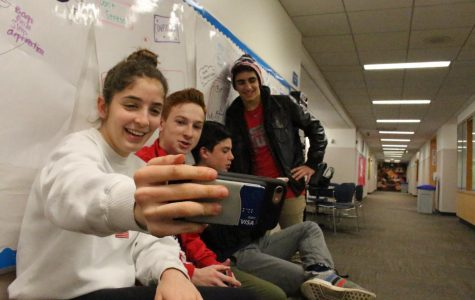 Sophomore Estelle Heltzer takes a selfie with Tomas Cattagio, Micah Derringer, and Max Antoniou to send to he Snapchat streaks.