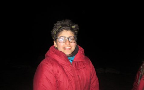 Olivia Garg wears a grass headband while hiking through the Utah Desert at night on her school orientation trip.