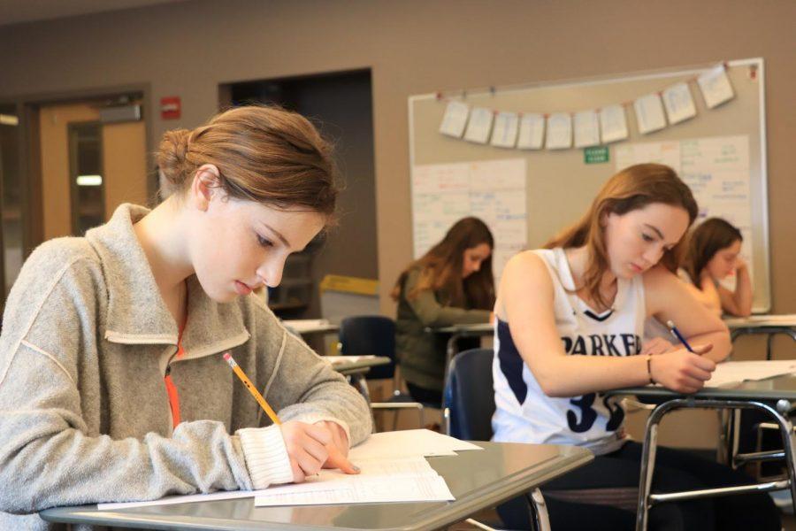 Caroline Conforti '20 (left) and Senna Gardener '20 (right) compete in the American Math competition.