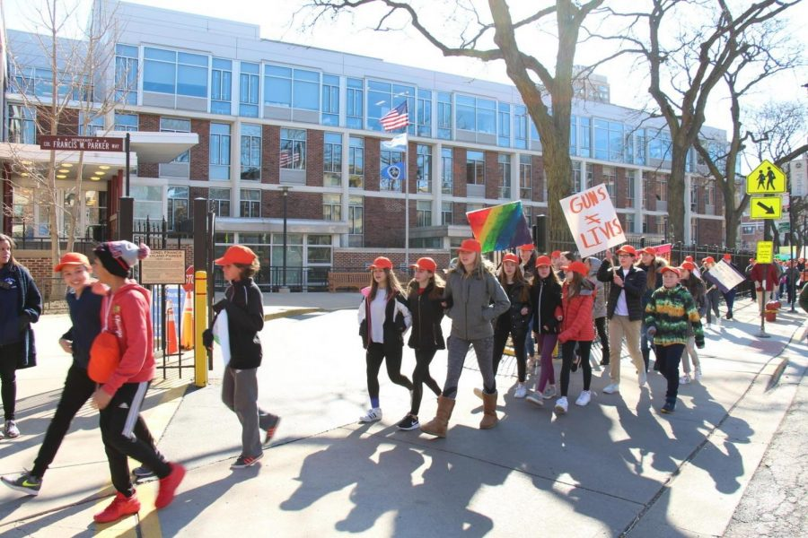 Middle School students march in front of Parker.