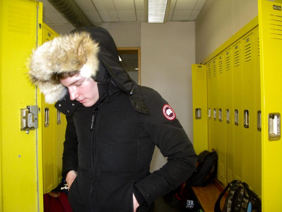 Sophomore and soccer team member Fin Gallagher sports his newly gifted Canada Goose jacket in the sophomore locker area.
