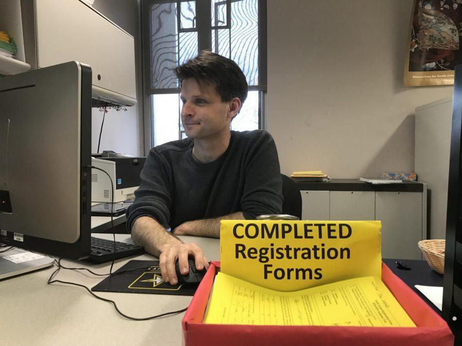 Registrar Matt McCaw works at his desk in his third floor office.