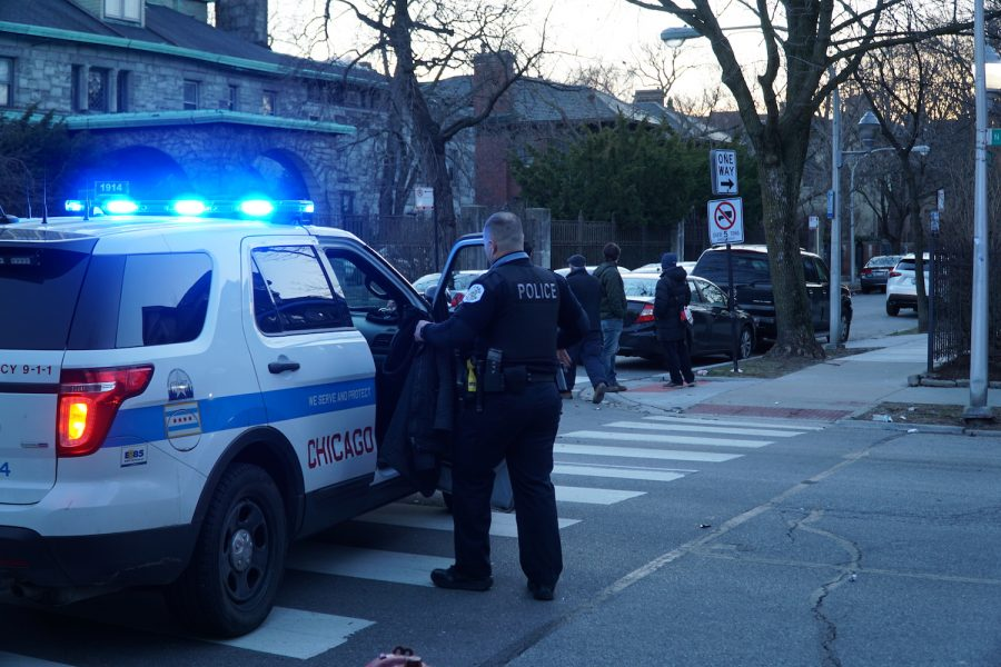 A Chicago police officer steps into his car after investigating a minor crime in Lincoln Park.