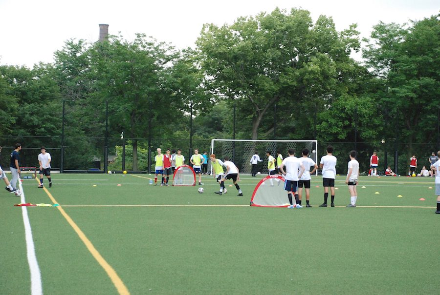 The high school boys soccer team train during their pre-season practice.