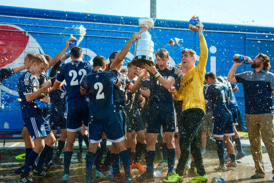 Parker's Boys Varsity Soccer Team celebrates victory with a Pepsi spray.