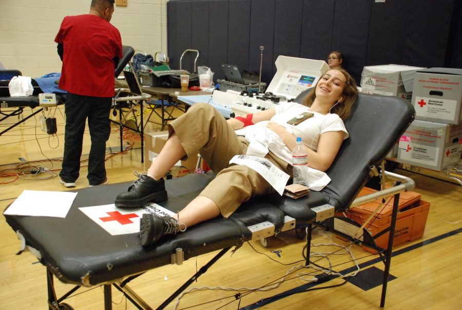 Senior Olivia Posner donates blood at the Red Cross blood drive.