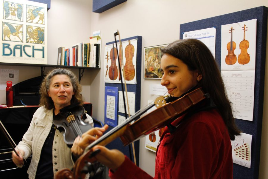 Sophomore Yildis Rihter practices violin in a private lesson with Betty Lewis.