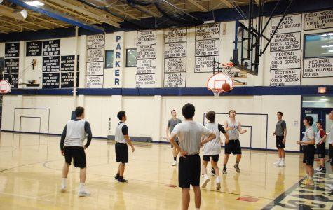 The high school boys basketball team practicing their free throw shots.