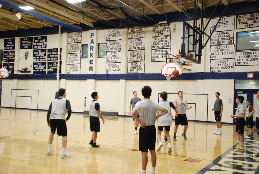 The high school boys basketball team practicing their free throw shots.
