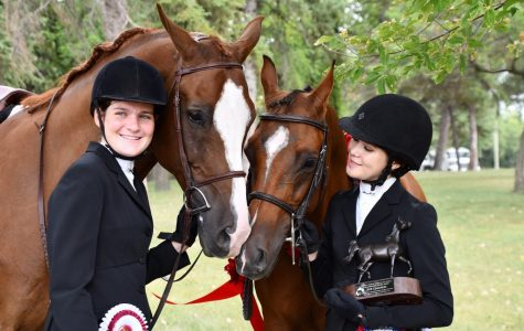 Buono (left) and Mansueto (right) admire their horses, Buggati LOE and Above Aire V, after placing seventh and first, respectively, in a hunt seat equitation class at Canadian Nationals in Manitoba.