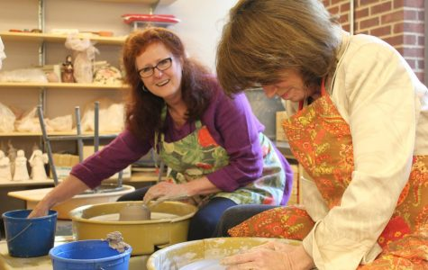 Cole (left) and Susan Weingartner illustrate the joy and concentration needed to create a thrown pot using a potter's wheel. Photo courtesy of Francis W. Parker School.
