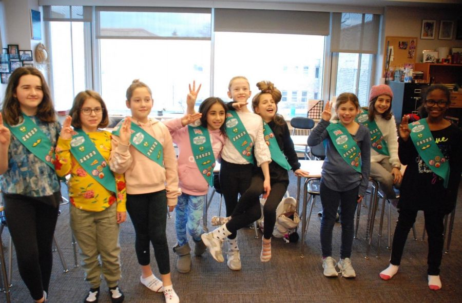 On my honor I will try... The Girl Scout Troop #24523 takes the Girl Scout pledge at one of their after school meetings.