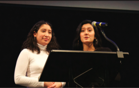 Juniors Gigi Lopez and Anjali Chandel, heads of Students Affirming Gender Equality (SAGE), speak at Gender Week's closing ceremony.