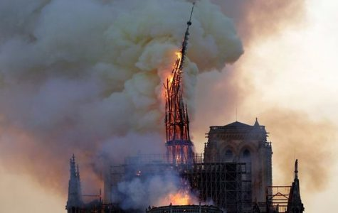 The spire on Paris' Notre Dame cathedral falls. Photo courtesy of the BBC.
