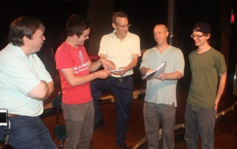 "David Alex works with the cast on the play ""Adrift."" Photo courtesy of The Daily Herald."