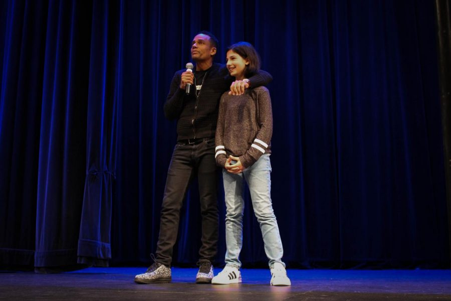 Hill Harper with a sixth grade student after inviting her up on stage to participate in the Morning Ex.