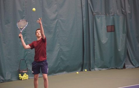 Junior Matthew Garchik serving at tennis practice.