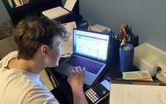 Freshman Gray Joseph checks the Portal while adjusting to completing his classes online.