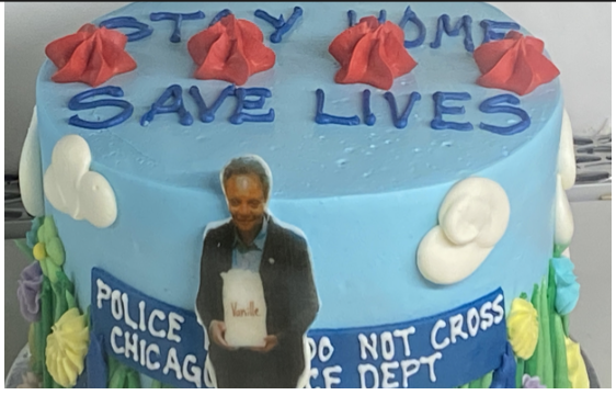 "On a cake by ""Vanille Patisserie,"" a bakery near Parker, Mayor Lori Lightfoot guards the lake front."