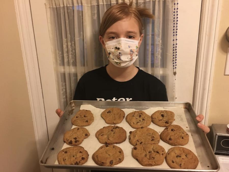 Back Back America volunteer from Girl Scout troop 1281 bakes cookies from West Lakeland, New York.