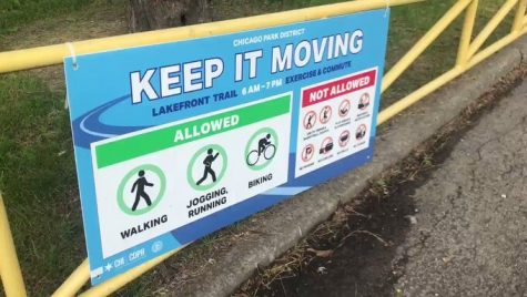 """Chicago Park District's new """"Keep It Moving"""" signs along the Lakefront Trail."""