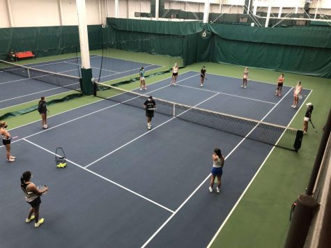 Girls tennis team at practice. Photo from Parker's portal.