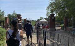 The Lincoln Park Zoo's entrance. Metal fences direct visitors into the zoo in an orderly fashion.