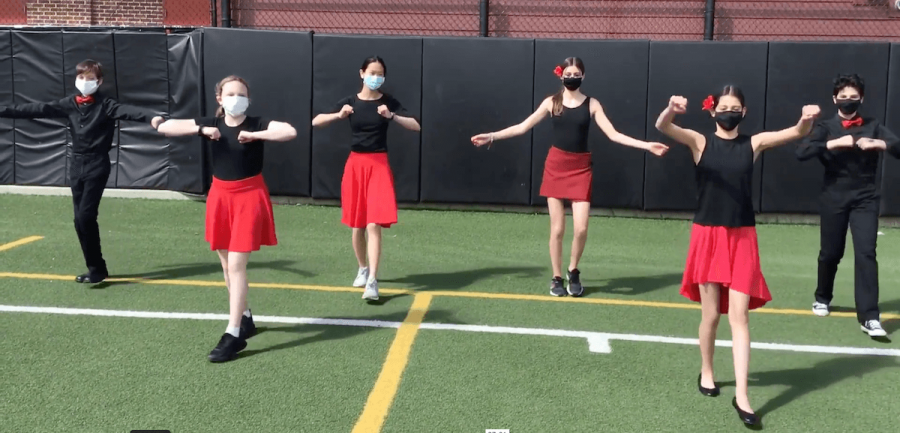 Students dancing on the field in the pre-recorded 7th Grade Latin Dance Project.