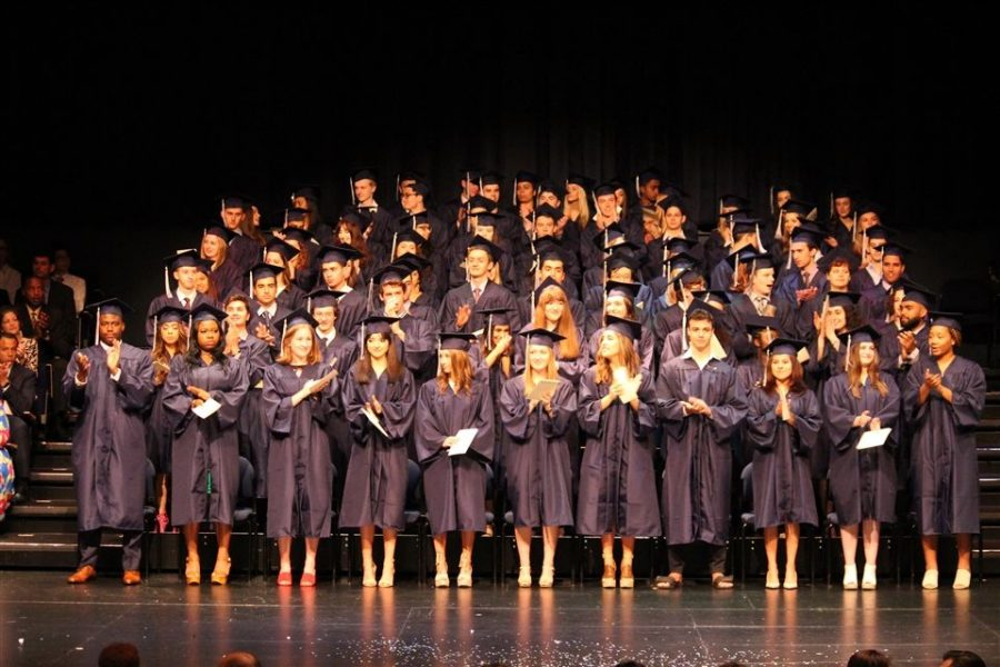The graduating class of 2018 celebrates in the auditorium, similar to what is expected for this year's class of 2021's graduation.