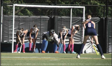 Five players from the Varsity Girls Fieldhockey team defend the goal during their Homecoming game versus Latin.